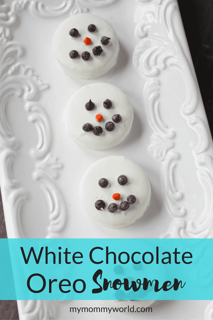 white chocolate Oreo snowmen on a white plate