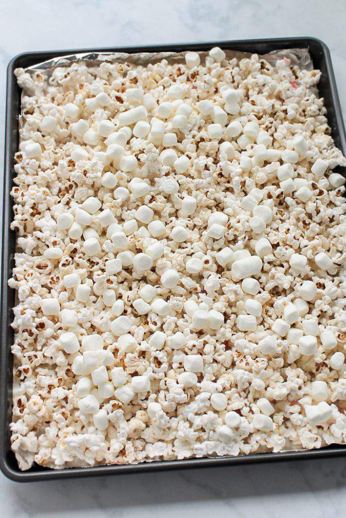 sheet pan with popcorn and mini marshmallows on it
