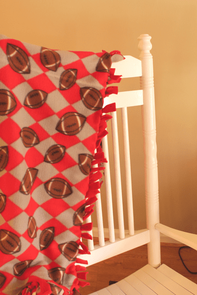 fleece blanket hanging over a rocking chair