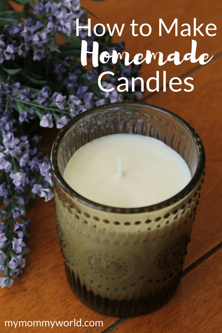 candle and lavender flowers on a table