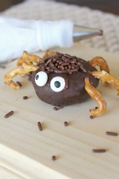 chocolate sprinkles added to top of donut spider