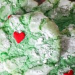plate of finished grinch crinkle cookies