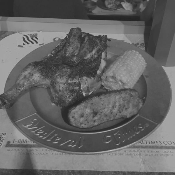 plate of food at medieval times consisting of chicken, potato and corn