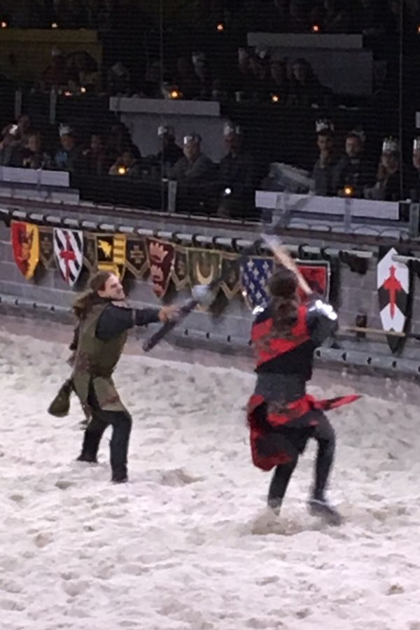 two knights fighting with swords at medieval times