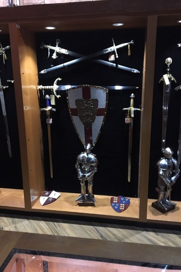 display of medieval era swords and shield in the medieval times castle
