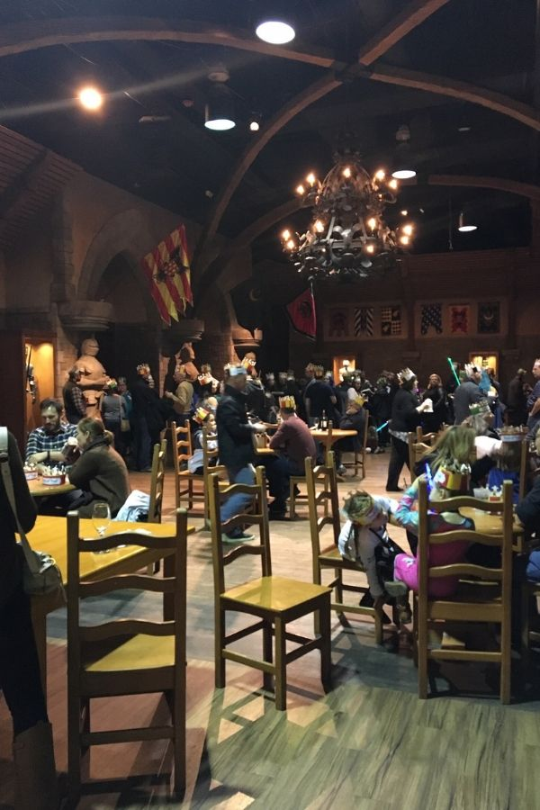 view of tables and chairs inside the waiting area at medieval times