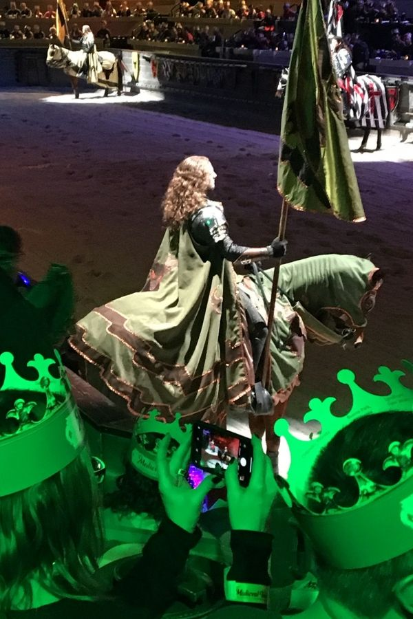 the green knight sitting on horseback