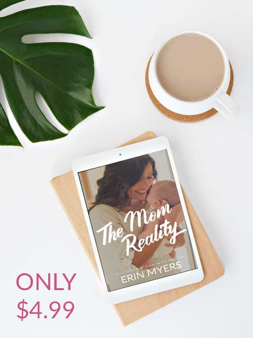 the mom reality ebook displayed on a tablet next to a cup of coffee.